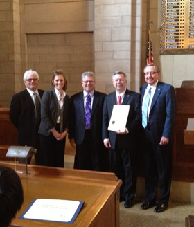 Mark & Insurance Colleagues Celebrate Their Industry with Governor Heineman